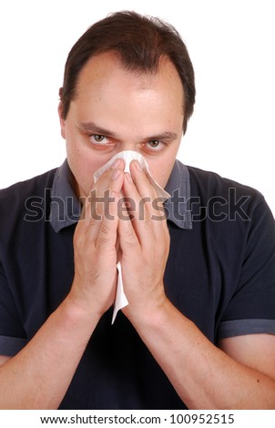 man is blowing nose