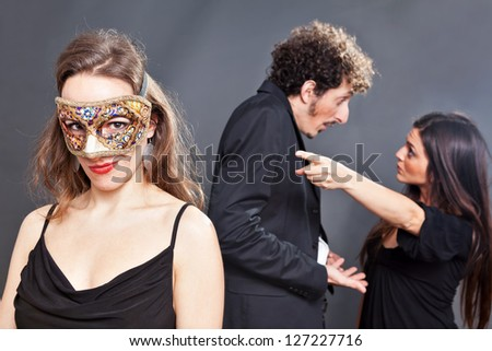 Man is caught red-handed with another masked girl - stock photo