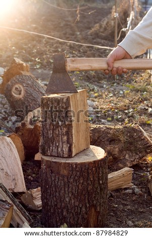 Man is chopping wood - stock photo