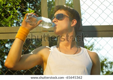 man is drinking fresh mineral water after sport - stock photo