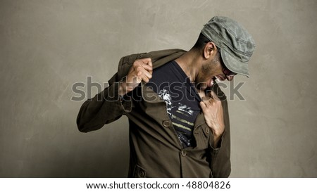 Man is frustrated and wants to be out of his clothes - stock photo