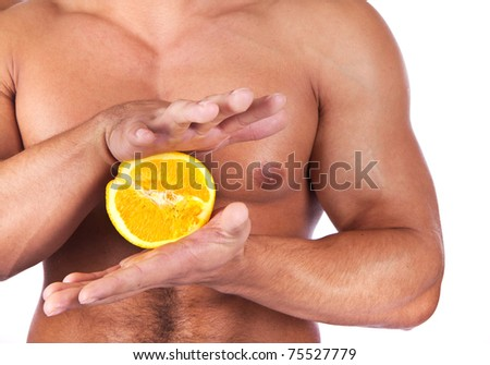 Man is going to squeeze a fruit - stock photo
