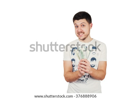 Man is happy about money he has - stock photo