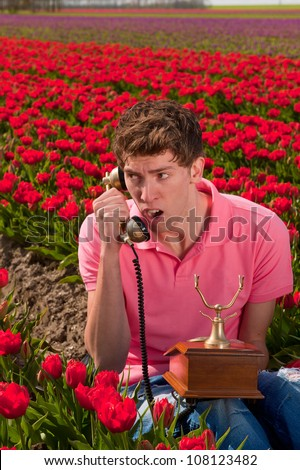 Man is having a phone call with vintage appliance - stock photo