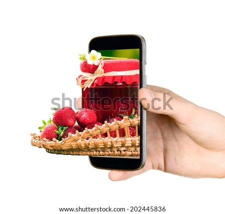 Man is holding mobile phone and showing strawberries - stock photo