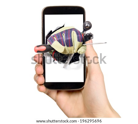 Man is holding smart mobile phone with industry tools on screen - stock photo