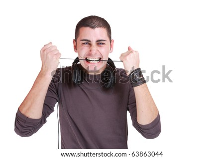 Man is listening to the music  on white background - stock photo