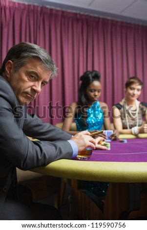 Man is looking tired sitting at the table - stock photo