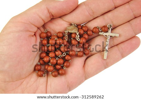 Man is offering or holding rosary with his hand on white background