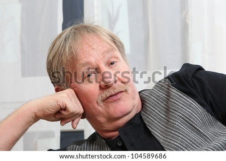 man is relaxing on a sofa