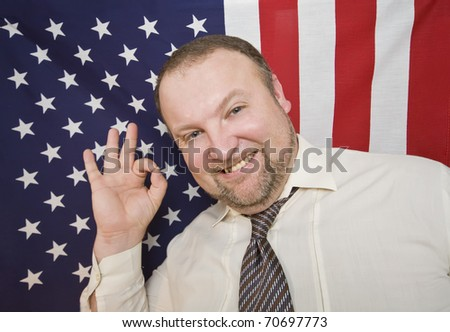 Man is satisfied with living in USA and showing OK sign