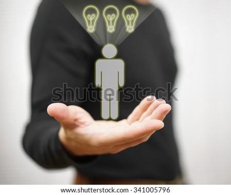 Man is showing virtual person with light bulbs above his head. Concept of employee with full of ideas - stock photo