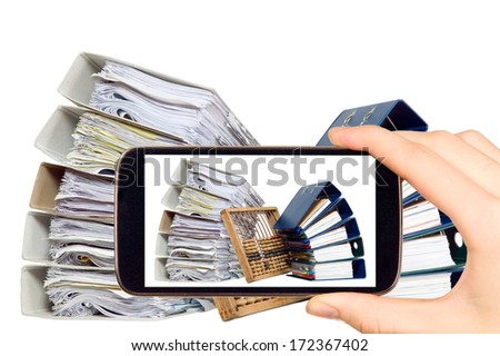 Man is taking photo of documents and abacus with smart mobile phone - stock photo