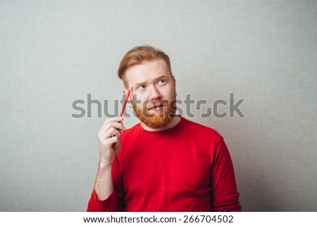 man is thinking about something with pencil - stock photo