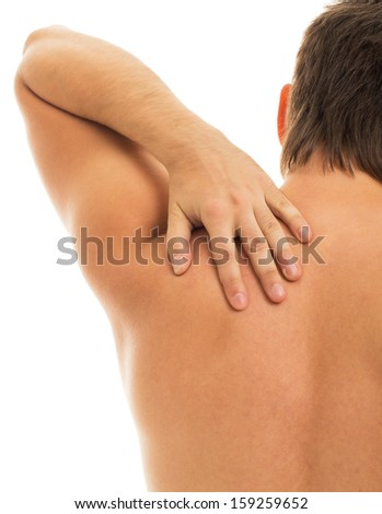 Man is touching his back because it aches