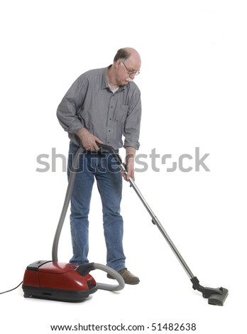 Man is using a vacuum cleaner isolated on white - stock photo