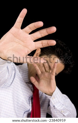 Man isolated on black hiding his head with the hands - stock photo