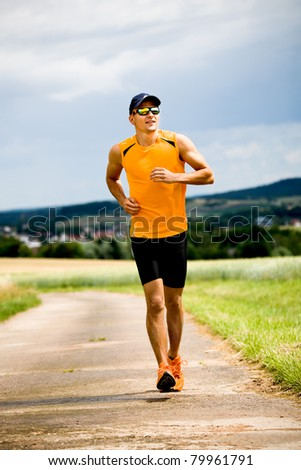 man jogging through the fields