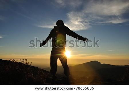 Man jump on sunrise scene - stock photo