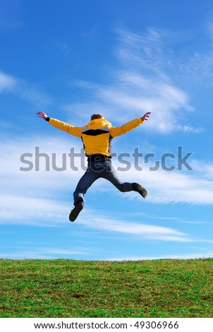 Man jump on the green meadow. Emotional scene. - stock photo