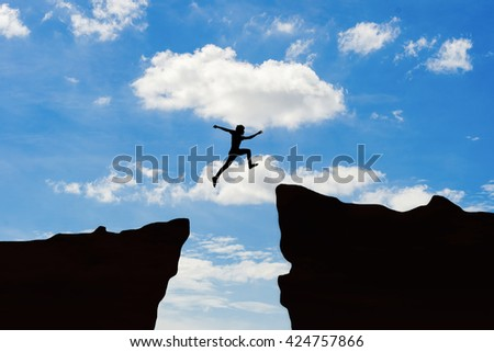 Man jump through the gap between hill.man jumping over cliff on sunset background,Business concept idea ,Olympic or sport symbol - stock photo
