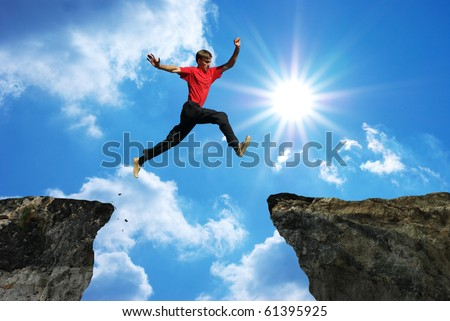 Man jump through the gap. Element of design. - stock photo