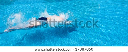 Man jumping in the pool