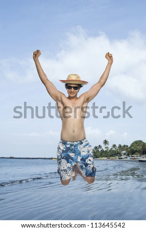 Man jumping on the beach - stock photo