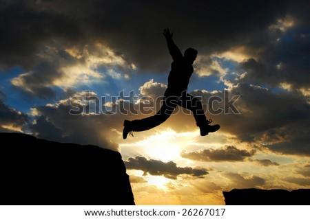 man jumping over a gap - stock photo
