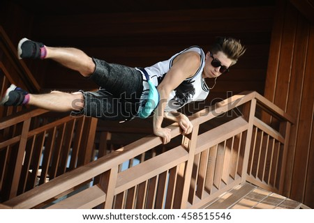 man jumping over the railing, parkour.