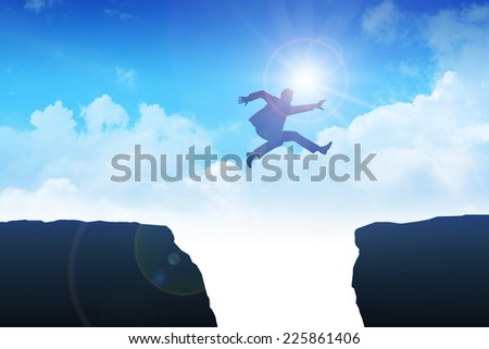 Man jumping over the ravine - stock photo