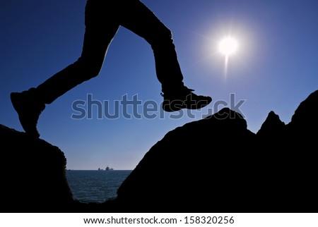 man jumping rocky - stock photo