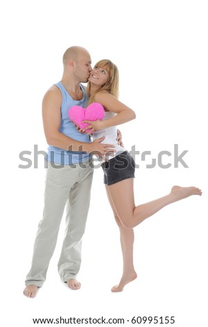 man kisses a girl. Isolated on white background - stock photo