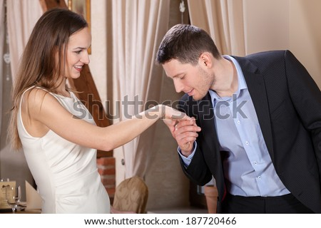 Man kissing his wife's hand before dinner - stock photo