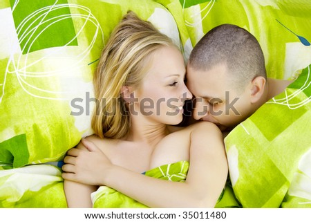 Man kissing woman`s shoulder. - stock photo