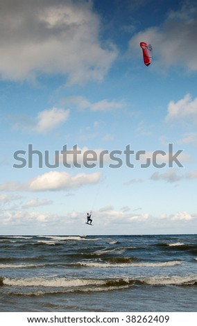 Man kiting on a wave