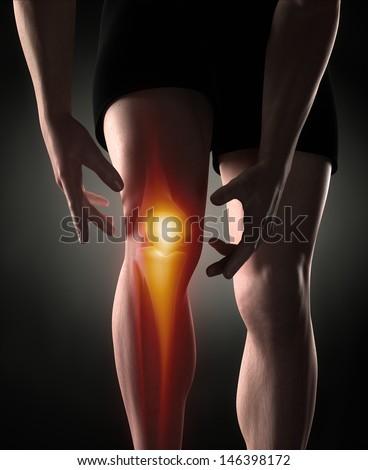 Man knee pain concept - stock photo