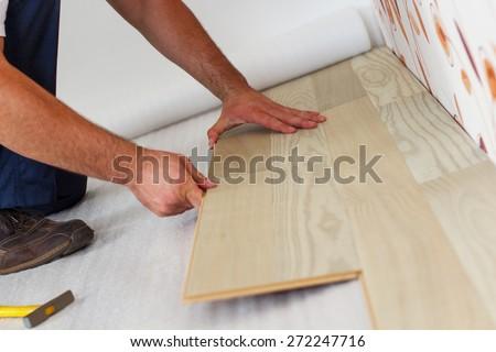 Laying Laminate Flooring install laminate flooring Man Laying Laminate Flooring In A Home