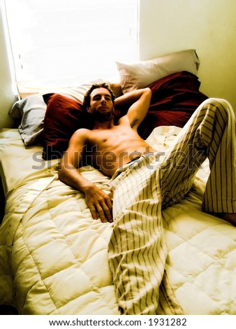 Man laying on bed (SOFT FOCUS)