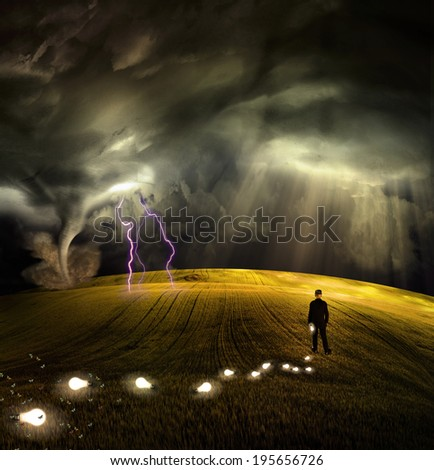 Man leaves trail of ideas in stormy field - stock photo