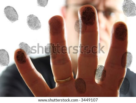 Man leaving fingerprints on glass