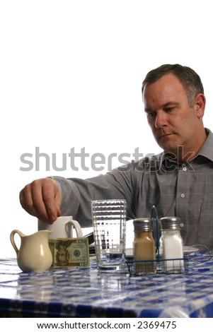 Man Leaving Tip at Restaurant - stock photo