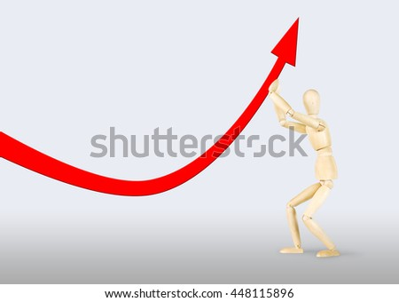 Man lifting a falling arrow upwards. Abstract image with a wooden puppet - stock photo