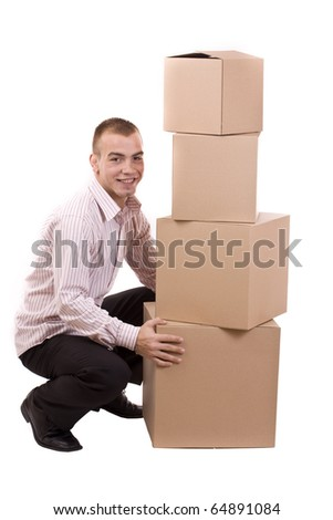 Man lifting lots of cardboard boxes - moving concept - stock photo