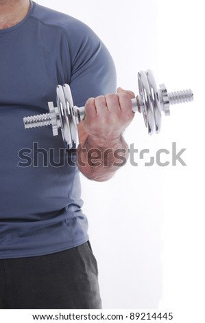 Man lifting weight against a white background - stock photo
