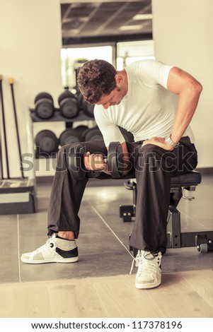Man Lifting Weights at Gym - stock photo