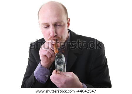 man light cigar with dollar note isolated on white. show of wealth and waste of money for bad smoking habit - stock photo