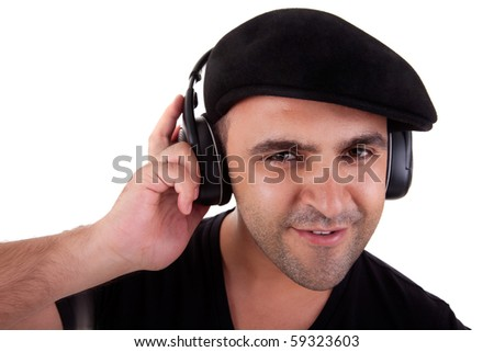 man listening music in headphones and smiling, isolated on white background, studio shot - stock photo