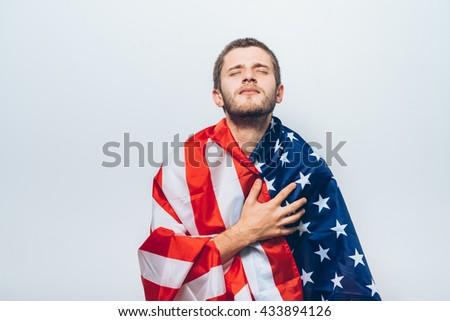 Man listening national anthem. Patriot. - stock photo