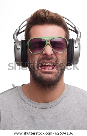 Man listening to music and singing along - stock photo